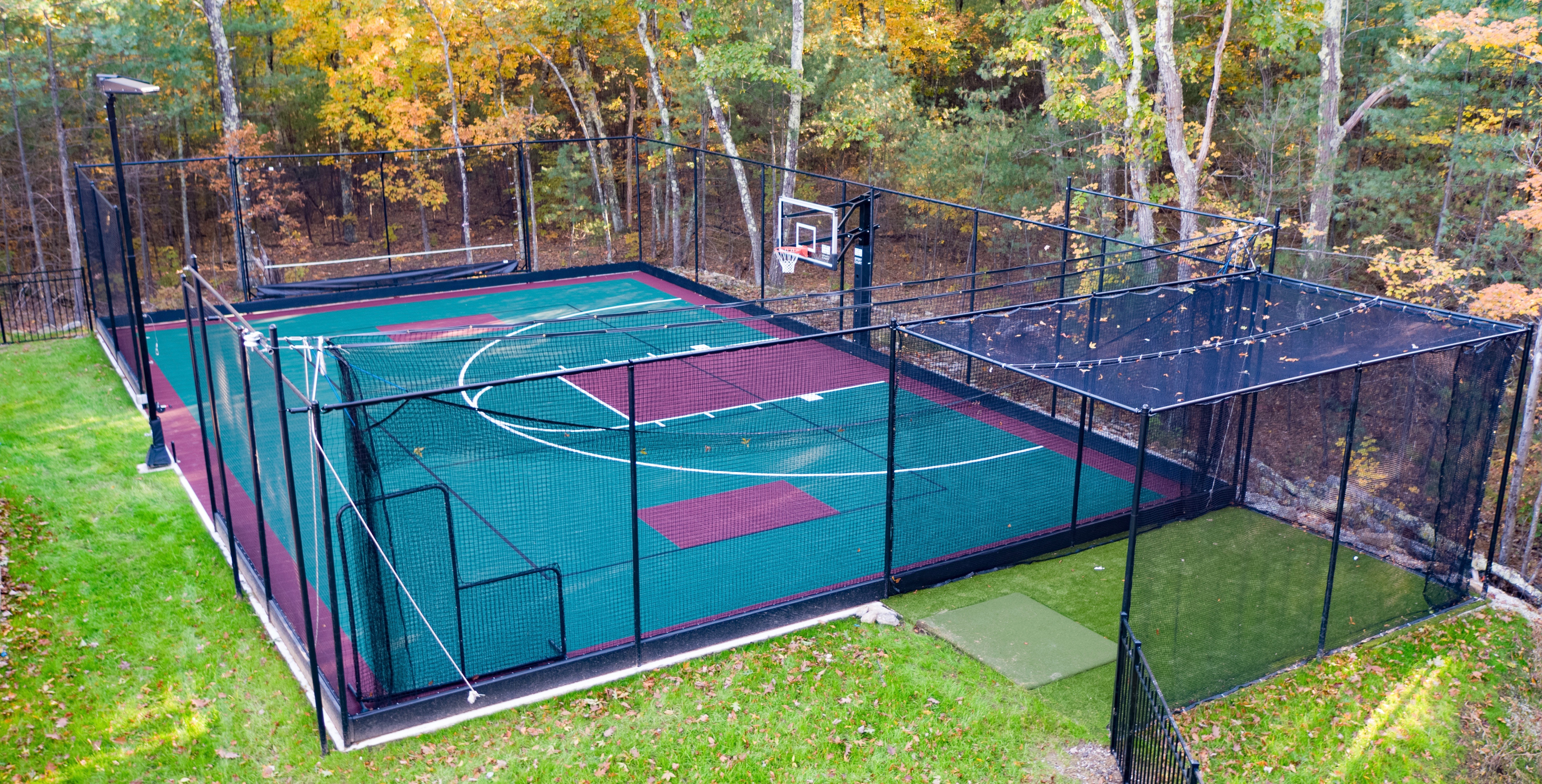 An outdoor basketball court, showing the work of indoor turf provider Sport Court New England servicing Lawrence, MA
