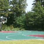 Backyard basketball court installed by Sport Court New England